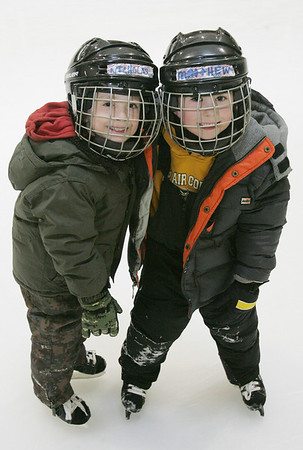 Brothers, Nicholas and Matthew McMillan, both 6, of Middleton enjoy skaing at the McVann O'Keefe Ice Rink in Peabody. Photo by Deborah Parker/January 5, 2009