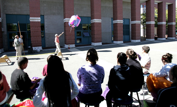 A group of seventh grade students watch as a paper balloon was released by Technology Education teacher Bob Brown yesterday afternoon at the Collins Middle School in Salem A group of seventh graders all gathered outside the school yesterday to watch their balloons filled with propane and to see how far they would travel. Photo by Deborah Parker/September 21, 2010