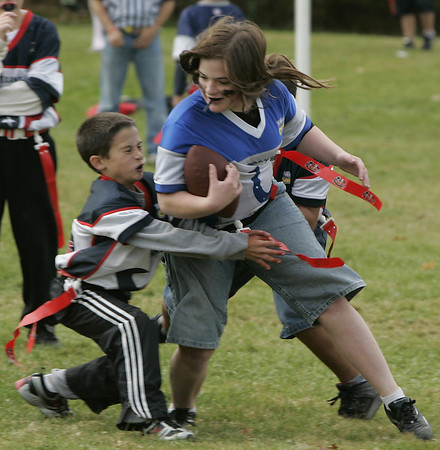 Peabody: Emma Driscoll is brought down by two defenders during their flag football game at Emerson Park Saturday. Photo by Deborah Parker/Salem News Saturday, October 25, 2008