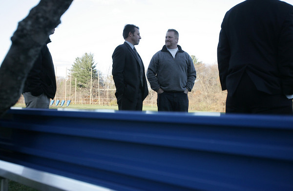 Mike McCarthy, father of Kevin McCarthy, a former Danvers High soccer player, who died in a car crash last month, talks with a coworker after learning a bench was being dedicated in his son's honor at the soccer fields at Danvers High. The bench and plaque were donated by some of Mike's coworkers from IBM, who surprised him with the dedication. photo by deborah parker/november 19, 2010