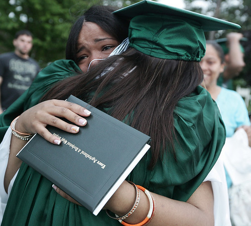 Claudia Weaver of Lynn and Kevin Goulart of Lawrence tearfully embrace following the graduation ceremony of Essex Agricultural and Technical High School Thursday evening. The class of 2009 graduated 85 students. Photo by Deborah Parker/June 4, 2009