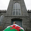 Salem: Reverand Phil Wyman stands in front of the First Church in Salem with a Welsh Flag. The church will be holding a big Wales Celebration on Saturday. Photo by Deborah Parker/Salem News Thursday, February 26, 2009.