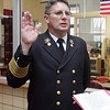 Newly promoted Fire Chief Paul Cotter is sworn in during a ceremony at Beverly Fire Headquarters Tuesday afternoon. Photo by Deborah Parker/February 2, 2010