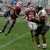 Saugus: Despite Saugus' Mike Dean's best effort, Marblehead's Sam Perlow sucessfully completes the pass during Saturday's game held in Saugus. Photo by Deborah Parker/Salem News Saturday, November 15, 2008.