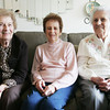 Phyllis MacDonald, 90, left, has lived at the Peabody House for the past four years, and this month her two sisters, Bernice Peddle, 88 and Margaret Legere, 93,  moved in to the building. Photo by Deborah Parker/January 22, 2009
