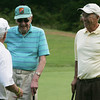 Ken Ring, center, is a 95-year-old golfer who still plays once a week with a group of friends at the Olde Salem Greens. From left, Spike Thibeault, Ken Ring and Bob Caron. Photo by Deborah Parker/July 12, 2010