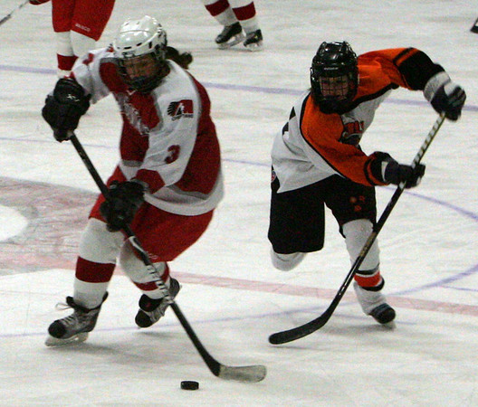 Masco's Nancy Palermo is pursued down the ice by Beverly's Brittany Russo at last night's game held at Talbot Rink in Gloucester. photo  by Deborah Parker/January 4, 2009