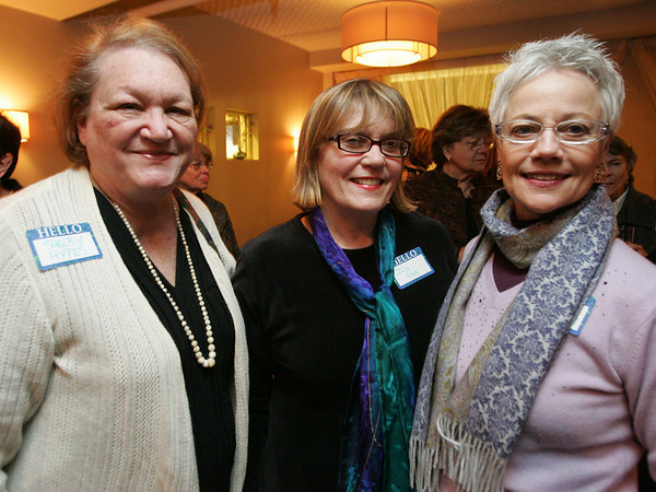 From left, Shelby Hypes, Julie Rose, and Jane Baldridge, all of Salem,  pose for a picture while attending a cocktail reception at Sixty2 on the Wharf to kick off the bicentennial year of the Salem Athenaeum. Photo by Deborah Parker/January 12, 2009.
