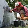 Tommy Gagnon works on painting several cement blocks at the entrance to the Salem Willows with images iconic to the city, such as a lobster, a lighthouse, a ship, a headstone and more. Photo by Deborah Parker/Septmeber 1,2 010