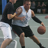 Beverly's George Kallas is defended by Peabody's Brian DeAngelis during Monday night's North Shore Summer League basketball game held at Plains Park in Danvers. Photo by Deborah Parker/August 2, 2010