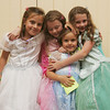 Cousins, from left, Maria Meimeteas, 9, Madeline Ambler, 8, Angelina Meimeteas, 4, and Alexandra Ambler, 8, all of Salem,  attend the Fancy Nancy Soiree at the Wenham Museum, Tuesday afternoon. Attendees were read a Fancy Nancy story, created a fancy craft and were treated to ice cream. Photo by Deborah Parker/August 24, 2010