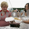 Salem: Elzbeita Suchecki of Ipswich, left, and Lucy Smlulk of Salem serve up a plate of traditional Polish food while at St. John the Baptist Parish's Polish Festival Sunday. Traditional polish foods such as pierogi, golabki, kielbasa, kapusta were served while polka music was provided by Stop. There was also an arts and crafts table, and a dunk tank.Photo by Deborah Parker/Salem News Sunday, September 07, 2008