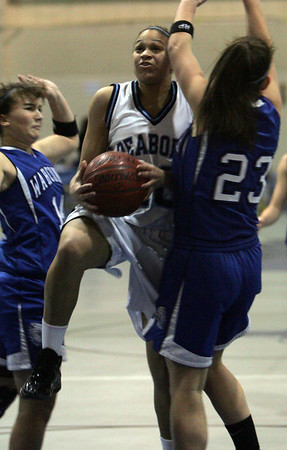 Peabody's Janelle Rodriguez trys to push her way throgh two Wahconah Regional High School defenders in front of net during last night's Tanner Cit Holiday Classic held at Peabody High School. Photo by Deborah Parker/December 29, 2009