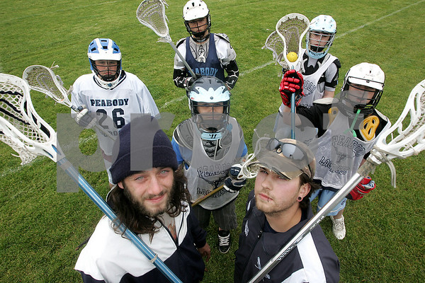 Peabody: Tom Gatti and Vinnie Cinseruli are the team coaches for the Peabody Youth Lacrosse U-13 team. They are both unconventional looking coaches but done a great job at relating to the kids and have coached the team well. Behind them are team members from left, Joe Powers, Nick Oullette, Keifer Heckman, Spencer Dean, and Sean Maribito. Photo by Deborah Parker/Salem News, Friday, June 6, 2008.