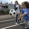 Danvers: Emily Smith, 9, and Rebecca Rocker, 6, both of Danvers race down the track with a game ball before the start of the Falcon's game game against the Beverly Panthers Thursday night at Deering Stadium. Photo by Deborah Parker/Salem News Thursday, September 25, 2008