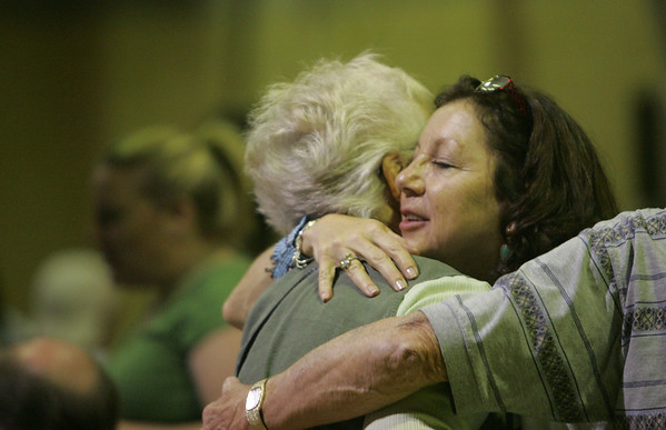 Marie Gauthier, mother of Julie Gauthier, a Salem teen who died in a car accident in March receives a hug from a family member during a benefit concert to help raise funds for a scholarship started in Julia's honor. Photo by Deborah Parker/may 7, 2010