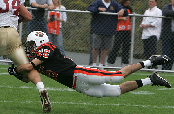Beverly's Curtis Manuel tries to bring down Gloucester's #34 in front of the end zone during yesterday's game held at Hurd Stadium. Photo by Deborah Parker/October 4, 2009