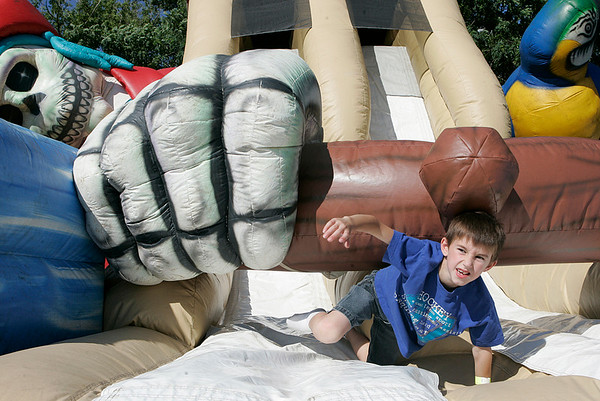 JR Cravotta, 7, of Danvers, plays pirate themed bouncy house during the Danvers Family Festival before the annual fireworks Sunday evening. The festival included a dj, food, rides, games and bouncy houses. Photo by Deborah Parker/July 5, 2009.