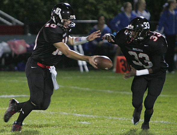 Georgetown's Hayes Richardson passes the ball to teammate Damarco Dooley during last night's game against Georgetown held at Marblehead High School. Photo by Deborah Parker/October 2, 2009