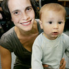 "Carolyn Pulaski and her son Owen, 1, of Swampscott, enjoy the ""Pirates Night"" family night program at the Swampscott Library Tuesday. The event included live pirate performers along with a temporary tattoo to wear through the evening. Photo by Deborah Parker/July 7, 2009."