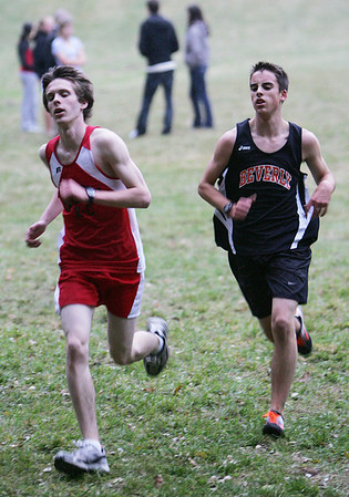 Salem's Stephen Trainor and Beverly's John Page compete in yesterday's meet at J.C. Phillips Nature Preserve in Beverly . Photo by Deborah Parker/October 27, 2009