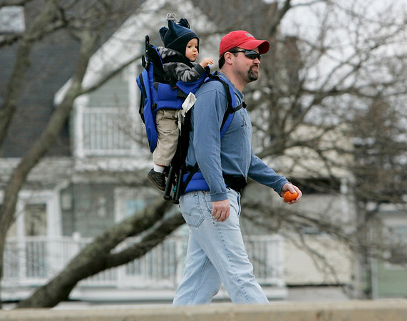 """Beverly: Matthew Ekstrom of Beverly took his son, Aidan, 16 months, for a walk along Dane Street Beach Sunday afternoon in usually warm weather. """"I'm loving this,"""" said Ekstrom. """"It allows us to go for walks like this."""" Photo by Deborah Parker/Salem News Sunday, December 28, 2008."""