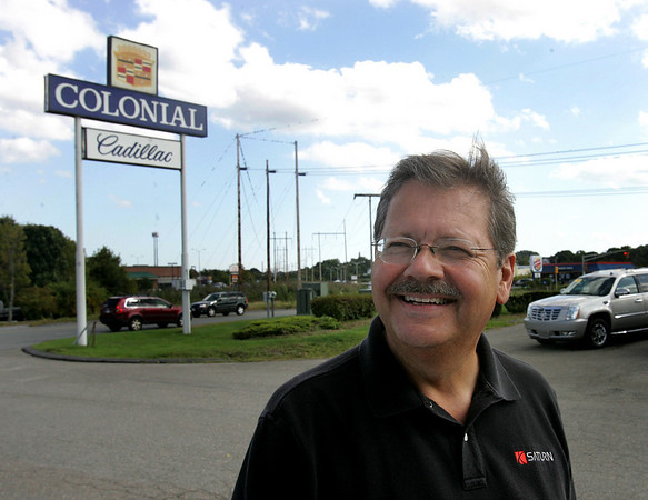 Hank Pizzo, business manager and dealer principle of Colonial Cadillac stands in the dealerships parking lot. The dealership will soon be closing. Photo by Deborah Parker/September 29, 2009