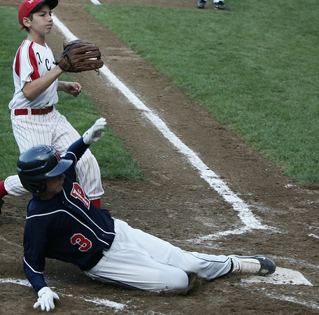 Peabody West's Austin Batchelder slides safely into home before Newton Central's Johnny Levenfeld could make the tag during yesterday's State Little League Final Four held at Harry Ball Field. Photo by Deborah Parker/ July 30, 2009