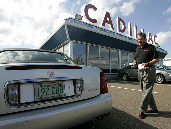 Hank Pizzo, business manager and dealer principle of Colonial Cadillac appraises a Cadillac in front of the show room. The dealership will soon be closing. Photo by Deborah Parker/September 29, 2009