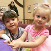 Dressed in their best, Catherine Peterman, 4, of Rockport and Laurel Brau, 4, of Gloucester, attend the Fancy Nancy Soiree at the Wenham Museum, Tuesday afternoon. Attendees were read a Fancy Nancy story, created a fancy craft and were treated to ice cream. Photo by Deborah Parker/August 24, 2010