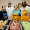 Beverly: Kiwanis Club members from left, Melissa Carr, Rene Gagnon, Katie Finch and Michel Leveque, serve up some green eggs and ham along with pancakes while the Italian Community Center Saturday morning. The Kiwanis Club held a breakfast, complete with characters and free books,  to celebrate Dr. Seuss' 105th birthday. Photo by Deborah Parker/Salem News Saturday, March 21, 2009.