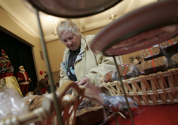 Beverly : Joanne Leger of Danvers searches for some baked goods to give to famiy members while visitng Salem's St. Peter's Episcopal Church Holiday Extravaganza Saturday. The event included, a raffle, along with several tables with crafts and food items to purchase. Photo by Deborah Parker/Salem News Saturday, November 15, 2008