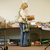 Lorraine Thompson of Essex searches through the children's book section while at the Hamilton-Wenham Library book sale Wednesday afternoon. Photo by Deborah Parker/September 16, 2009