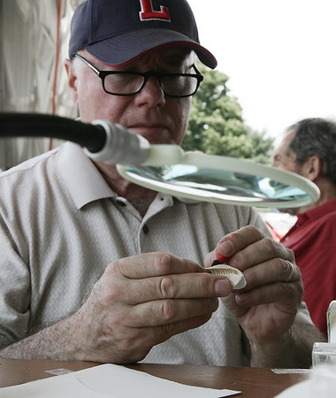 Frank Comier of Beverly and part of the U.S.S Constitution Model Shipwright Guild works on creating a small model boat that will be placed along with larger model boats during the Antique and Classic Boat Festival held at Hawthorne Cove Saturday. Photo by Deborah Parker/August 22, 2009