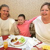Beverly: From left, Rebecca Keener and her daughter Cheyanne Russell of Beverly along with Sandy Gray of Peabody enjoy a serving of green eggs and ham along with pancakes while the Italian Community Center Saturday morning. The Kiwanis Club held a breakfast, complete with characters and free books,  to celebrate Dr. Seuss' 105th birthday. Photo by Deborah Parker/Salem News Saturday, March 21, 2009.