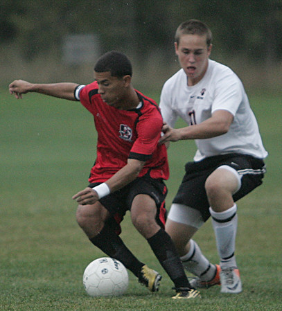 Salem's Edwin Demoya fights to maintain control of the ball while being defended by Beverly's Cam Rodgers during Beverly's game against Salem Tuesday afternoon. Photo by Deborah parker/september 28, 2010