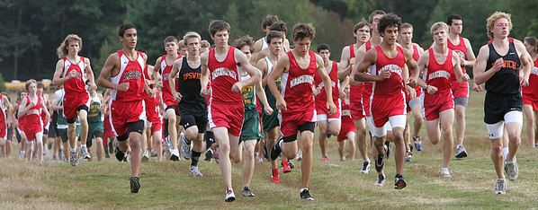 Members of the Masconomet boys cross country team compete against Ipswich, North Reading and Amesbury during yesterday's meet held at Bradley Palmer State Park. Photo by Deborah Parker/September 23, 2009