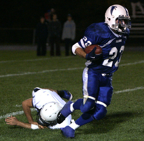 Danvers: Danvers' T.J. Stanley escapes a tackle by Peabody's Mike DiFrancisco during last night's game at Deering Stadium at Danvers High School.<br /> Photo by Deborah Parker/Salem News Friday, October 03, 2008