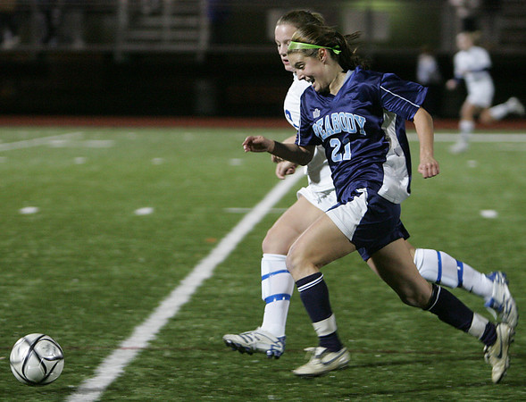 Peabody's Hayley Dowd chases down the ball against  Acton-Boxboro's Kristen Gargiulo in Division 1 North soccer final held at Fraser Field in Lynn Monday evening. Photo by Deborah Parker/November 16, 2009