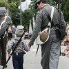 Brian Beck of New Hampshire holds the hand of his son Henryk while marching in Ipswich's 375th anniversary parade Sunday afternoon. Photo by Deborah Parker/ August 9, 2009
