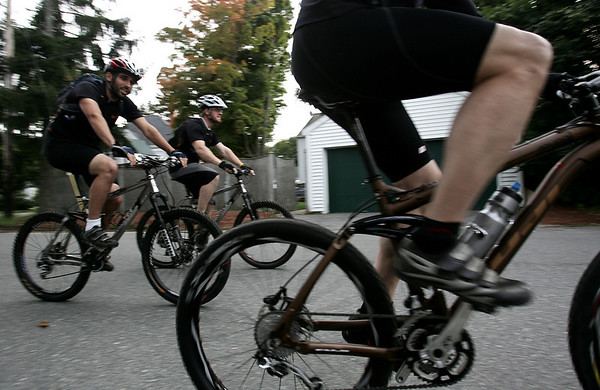 Bill Kerr, owner of Beverly Cycles, far right, leaves for a ride right from the store with Ben Padilla, a student at Gordon, far right and Tom Wellwood of Hamilton. Kerr regularly organizes rides that leave from his store. Photo by Deborah Parker/September 10, 2009