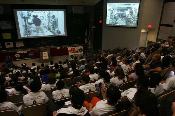 10 Salem students participated this summer in a program at Salem CyberSpace in which they programmed a space robot which is used at the International Space Station. On Thursday they were invited to MIT along with other students groups from around the state to compete and watch the robots perform live in space. Here the students watch a live feed of an astronaut working with the robots at the space station. Photo by Deborah Parker/August 19, 2010