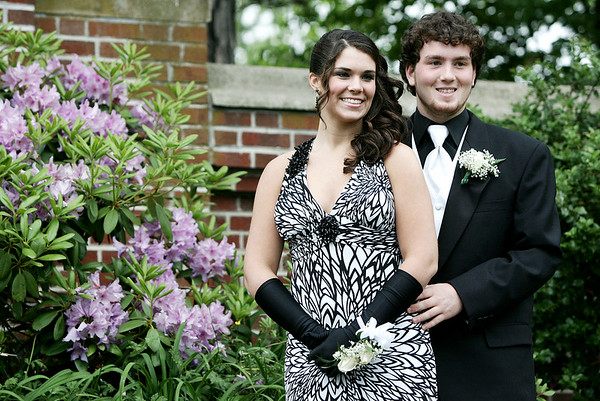 Christina Dube and Paul Fickenwirth, both seniors at Beverly High School pose together for family and friends at Lynch Park before prom Thursday evening. Photo by Deborah Parker/June 11, 2009