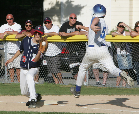 Peabody West's Bobby Sullivan makes the out at first against Stoneham's Chris Lenzilli during the Little League Sectional Championship held at Weafer Park in Worburn, Monday evening. Photo by Deborah Parker/July 25, 2010