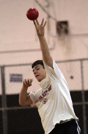 Andrew Convicer works on some throwing drills during practice for Winter track at Beverly High School Friday afternoon. Photo by Deborah Parker/December 4, 2009