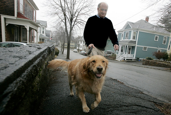Beverly: Bill McDonough has not owned a cell phone for twelve years. One of the freedoms he finds without a cell phone is that he can walk his dog, Ellie with out any disruptions. Photo by Deborah Parker/Salem News Friday, April 3, 2009.
