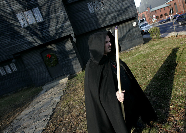 "Salem: Eric Fraize the ""Witch King of Salem"", stands in front of the Witch House which recently turned down a request from Spirit Finders Paranormal Investigatros of Rhode Island to conduct a scientific investigation inside the Witch House. Fraize, represented the organization before the Park and Recreation Comission and would have participated in the investigation. Photo by Deborah Parker/Salem News Thursday, December 18, 2008"