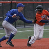 Salem State's David Waldron is tag out by Brandeis' Dylan Britton near third base during yesterday's game held at Salem State College. Photo by Deborah Parker/March 22, 2010