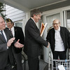 Joseph Quattrochi is presented with an American flag by Congressman John Tierney after his flag was stolen off of his fronch porch. Presenting the flag along with Tierney was Mayor Bill Scanlon and Ron Innocenti, Commander of American Legion Post 331.  photo by deborah parker/november 23, 2010