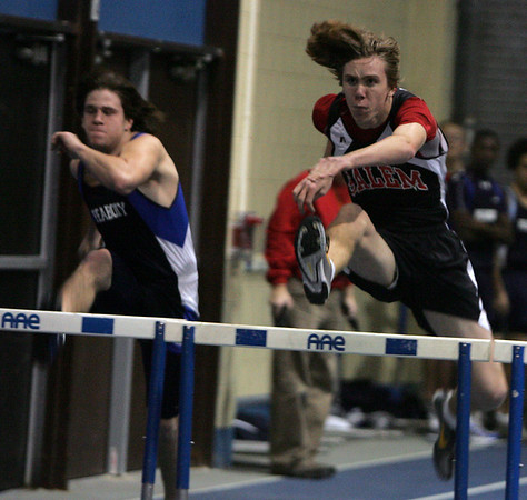 From left, Peabody's Joe Losanno and Salem's Ben Dibble compete in the 50 yard hurdles during last night's track meet held at Peabody Veterans Memorial High School. Photo by  Deborah Parker/December 14, 2009
